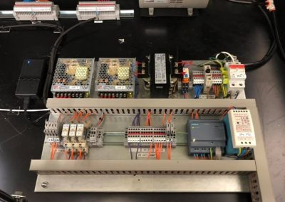Automated vacuum UV exposure unit control circuit modifications with HMI interface